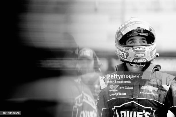 This image was converted to black and white] Jimmie Johnson driver of the Lowe's for Pros Chevrolet stands by his car during practice for the Monster...