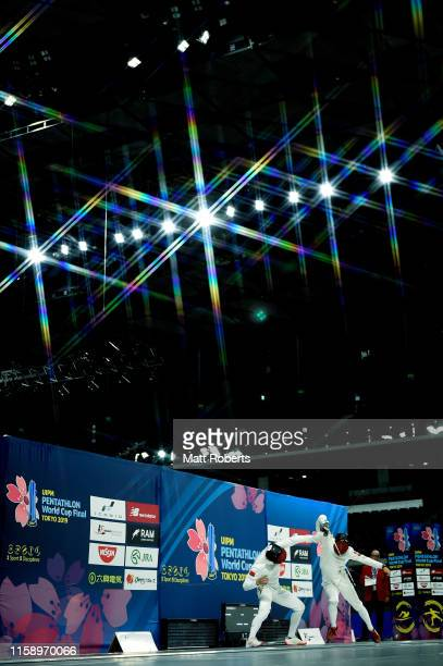 This image was created using a starburst filter.) Linbin Zhang of China competes against Shuhuan Li of China competes during the men's fencing bonus...