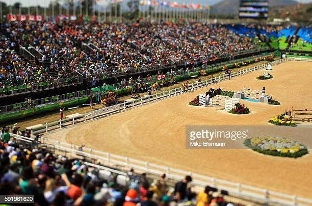 This image was created using a variable plane lens] Henrik von Eckermann of Sweden riding Yajamila competes during the Equestrian Jumping Individual...