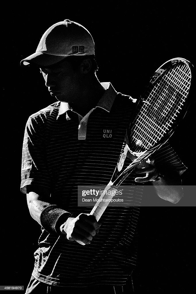 This image was processed using digital filters) Kei Nishikori of Japan walks out to play against David Ferrer of Spain in their quarterfinal match during day 5 of the BNP Paribas Masters held at the at Palais Omnisports de Bercy on October 31, 2014 in Paris, France.