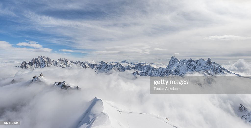 This images is taken above 13.000 feet / 4000 meters up. Looking over the mountains in Chamonix, Alps. A spring day.