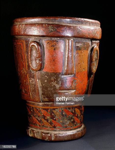 This Inca kero, a wooden goblet, was used by people of high status during religious rituals, This example is an effigy representing a stylized big...