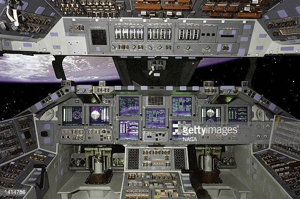 This interior view of the STS101 Atlantis Space Shuttle shows the eleven new fullcolor flatpanel display screens in the cockpit The shuttle is...