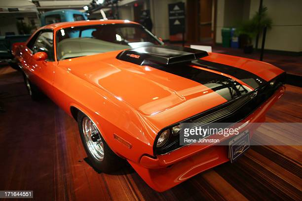This is a 1970 Dodge Challenger with a 440 V8 6 Pack a great example of an early Muscle Car Muscle Cars are American high power rear wheel drive cars...