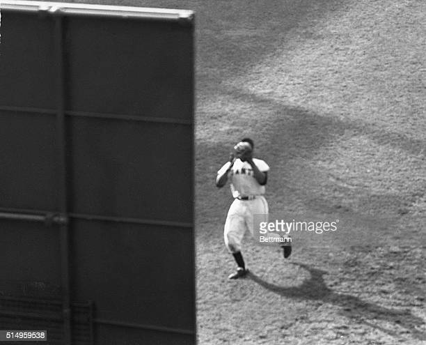 This is a bleacher view of Giant Willie Mays' gamesaving eighthinning catch of Cleveland's Vic Wertz' 450 foot drive to right center field at the...
