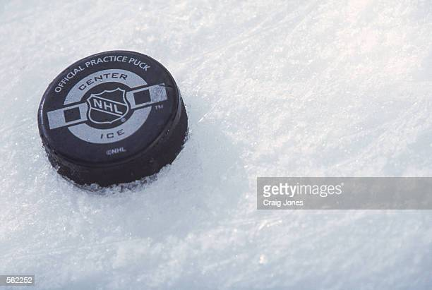 This is a close up of a hockey puck. The picture was taken during the NHL game between the Carolina Hurricanes and the Minnesota Wild at the...