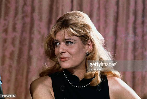 This is a close-up of actress, Melina Mercouri as she holds a press conference on July 12th, after being stripped of her Greek citizenship for...