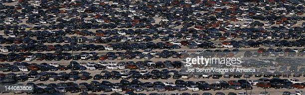 This is a commuter parking lot across from Manhattan or New York New York There are rows and rows of cars parked side by side