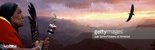 This is a digital collage of a Native American Indian looking out over the Grand Canyon There is an American bald eagle soaring high over the canyon