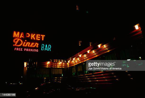 This is a diner on the Westside highway It has neon lights on the outside
