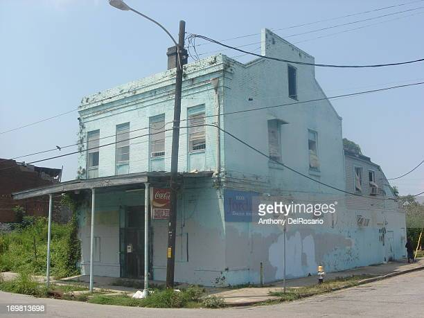 This is a former corner store in Central City, New Orleans, Louisiana. It had a stencil of a brass band wearing gas masks which was done by Banksy in...
