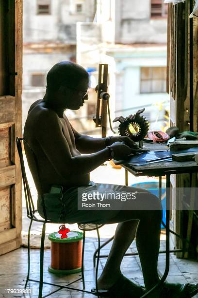 This is a man with a small home-based buisiness rebuilding old electric motors in the Vedado district of Havana, Cuba.