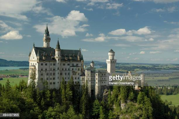 CONTENT] This is a panoramic view onto Castle Neuschwanstein from a public bridge on the opposite facing mountain