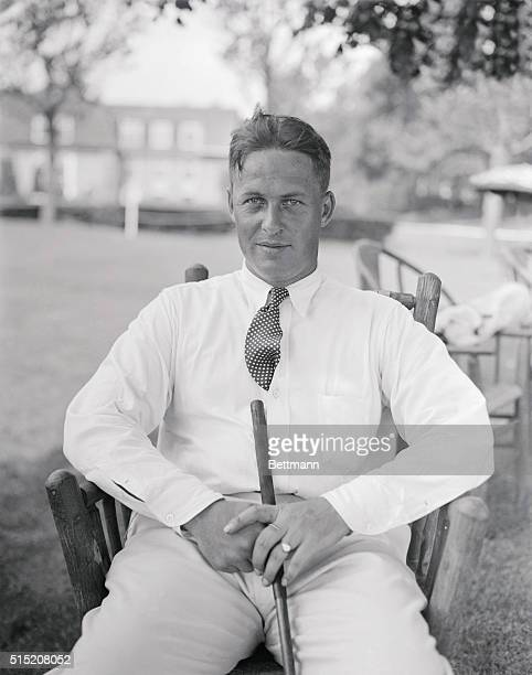 This is a photo of Bobby Jones golf sitting with his golf club