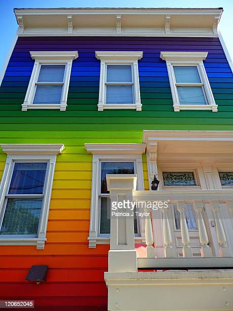 This is a photograph of a rainbowhue painted homeThis images was taken in San Francisco CA