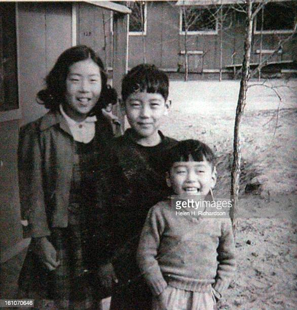 This is a picture of the Homma children when they were internees at Camp Amache in 1942 They are from left to right Kumiko Homma Hisao Homma and...