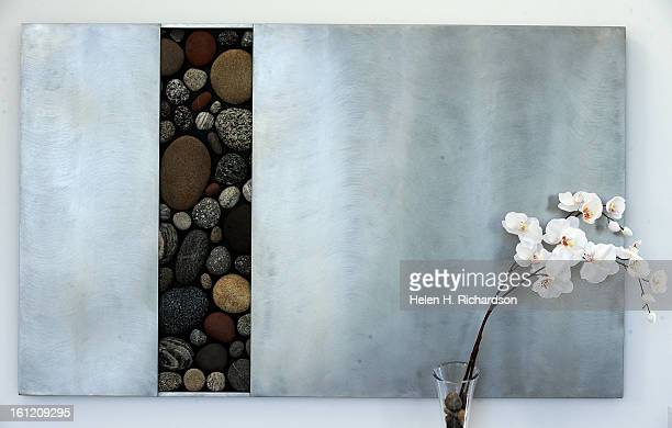 This is a piece of artwork in the house This is the home of Cathleen Van Buskirk and her snazzy home at the Erie Air Park Her sleek modern house is...