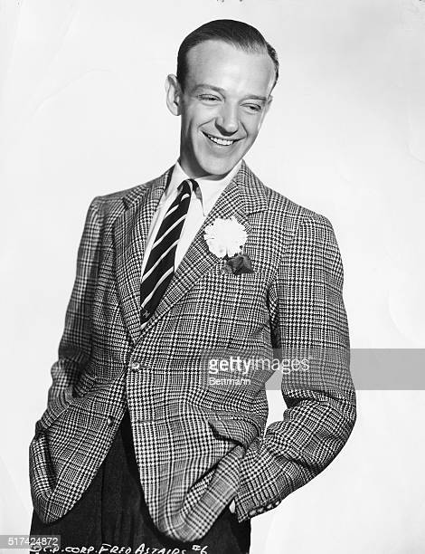 This is a portrait of actor and dancer Fred Astaire looking to the side and smiling