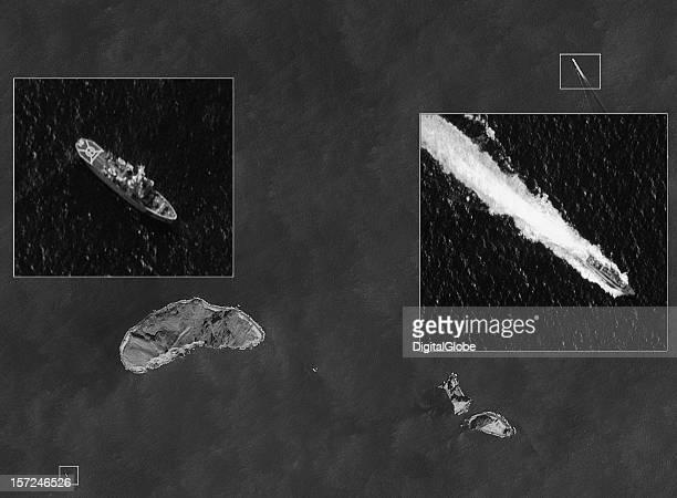 This is a satellite image of the Senkaku Islands of Uotsurijima Kita Kojima and Minami Kojima along two Japan Coast Guard vessels are visible on...