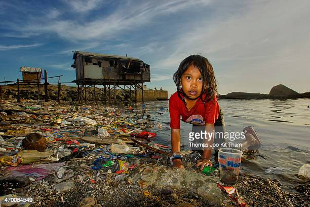 This is a scavenger having fun at the garbage sea of Tondo Manila. There is no water supply at the landfill thus the children got to wash themselves...