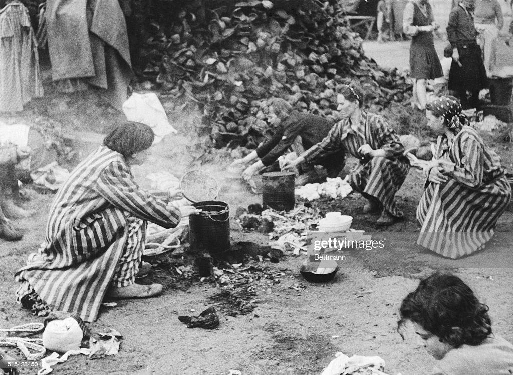 German Prisoners Kneeling on Ground at Belsen Concentration Camp : News Photo