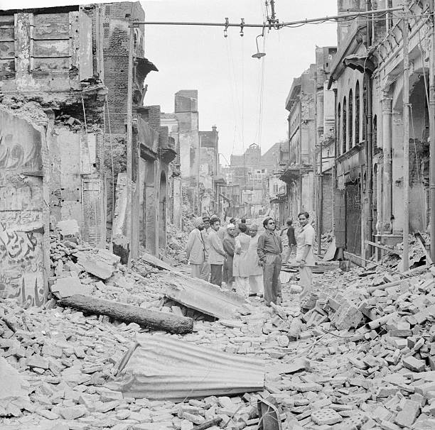 This is a scene where hundreds died in riots Ruins are a result of street fighting among Sikhs Hindus and Moslems