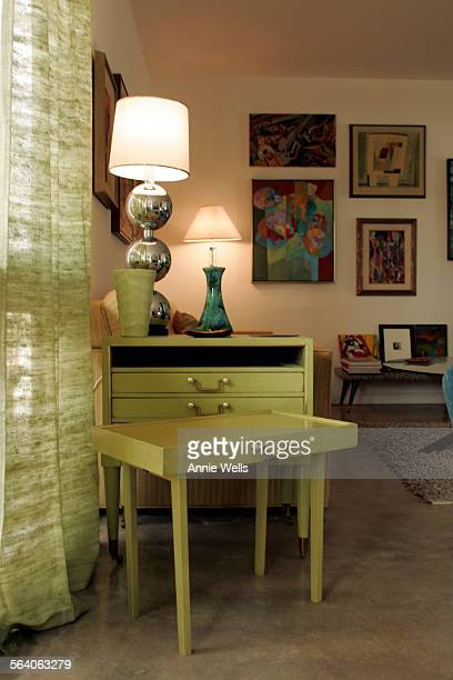 This is a side table with folding TV tables that pull out For INTERIOR MONOLOGUE The focus is on how the owners of a 60's Palm Springs tract home Bob...