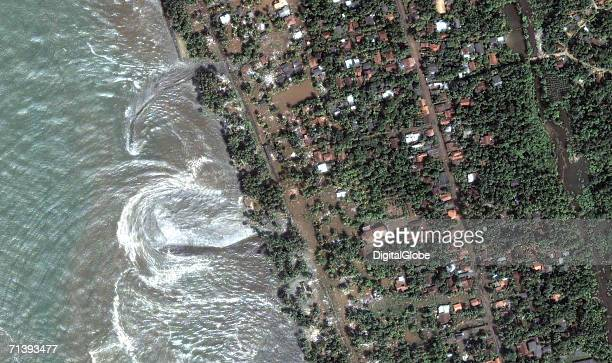 This is a true color satellite image of Kalutara Sri Lanka colllected on December 26 2004 This image shows a flooded area after a tsunami hit the...