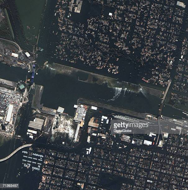This is a true color satellite image of New Orleans Louisiana collected August 31 2005 This image features Surekote levee that broke after Hurricane...