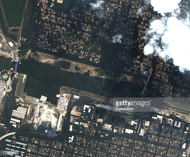 This is a true color satellite image of New Orleans Louisiana collected on September 3 2005 This image features teh Surekote levee break after...