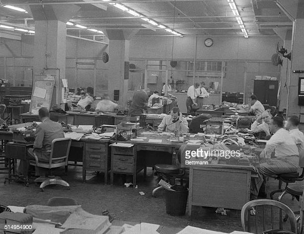 This is a view of part of the city room at the New York Herald Tribune, as the strike of the photo engravers union went on through its fifth day. The...