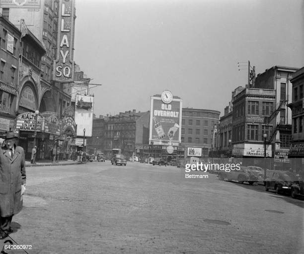 This is a view of Scollay Square with an Old Overholt advertisement beneath the clock tower