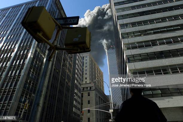 This is a view of the burning World Trade Center towers from Park Place Street and West Broadway Avenue during the deadly terrorist attack September...