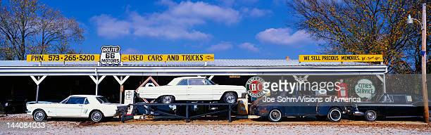 This is a vintage used car dealer along Route 44 It is the former Old Route 66 It is a true piece of Americana There is a vintage Mustang and a white...