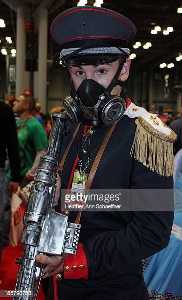 This is a young male cosplayer with an elaborate gun, costume and mask at the 2013 New York Comic Con.