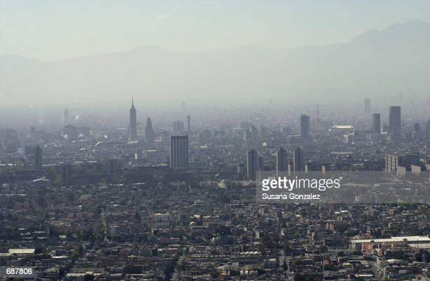 This is an aerial early morning view of Mexico City December 13 2001 in Mexico It is possible to see the pollution in the air over the city Some...