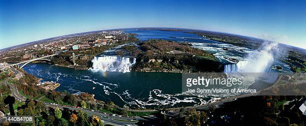 This is an aerial view of Rainbow Bridge the American Falls and Horseshoe Falls It is the view from Skylon Tower in Canada