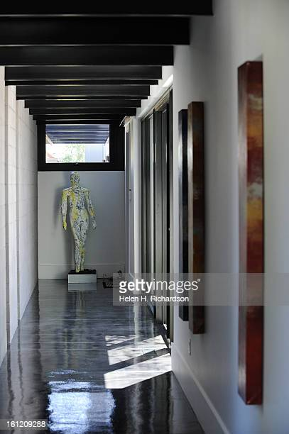 This is an art filled hallway leading to the hangar and the garage This is the home of Cathleen Van Buskirk and her snazzy home at the Erie Air Park...
