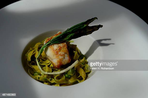 This is an entree of fresh grouper from the Gulf of Mexico with tagliatelle pasta with pesto and fresh garbanzo beans and ramps on top prepared by...