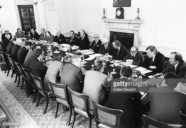 This is believed to be the first ever photograph taken of a British Prime Minister and members of his Cabinet in session at No 10 Downing Street 12th...