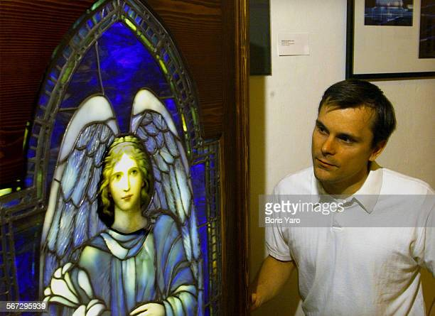 This is David Judson whose family has been making stained glass windows for over a century Here he stands a stained glass entitled 'The Blue Angel'...