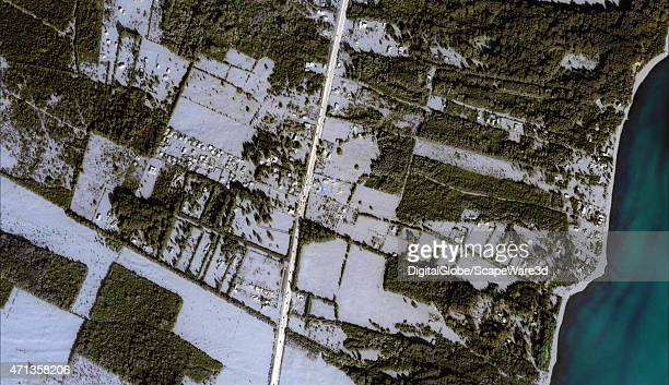 """This is DigitalGlobe via Getty Images """"natural color"""" satellite imagery of the ash covering a nearby village. About 23½ inches of ash fell and..."""
