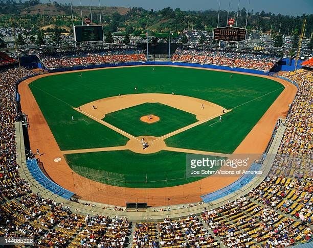 This is Dodger Stadium This game was played by the LA Dodgers and the Houston Astros The attendance at this game was 42 The Dodgers won with a score...
