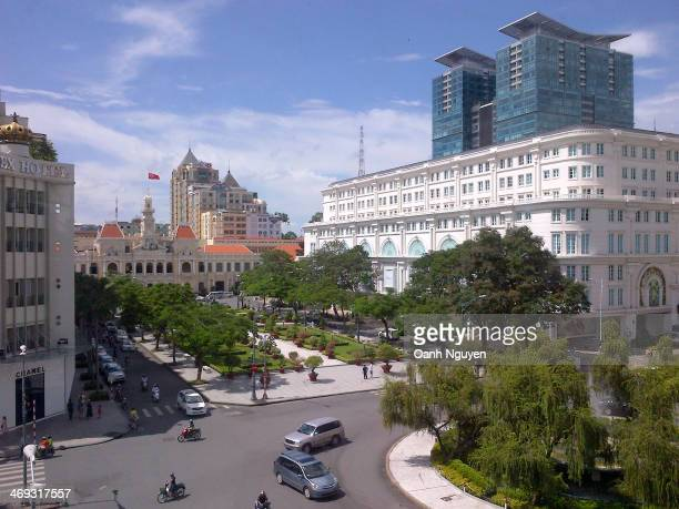 This is downtown Saigon Area in front of HoChiMinh People's Committee Building at noon time. The Rex Hotel on the left sight was renovation 3 yeas...