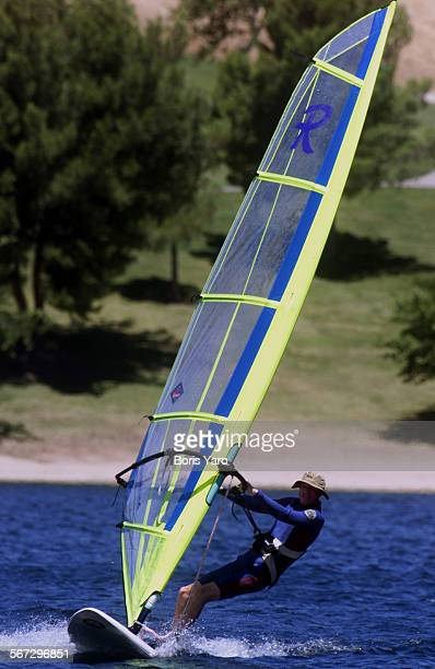 This is Gary Allen of Castaic He is a contractor who took a couple of hours off work to enjoy wind surfing on Castaic Lake on June 14 2000^^^