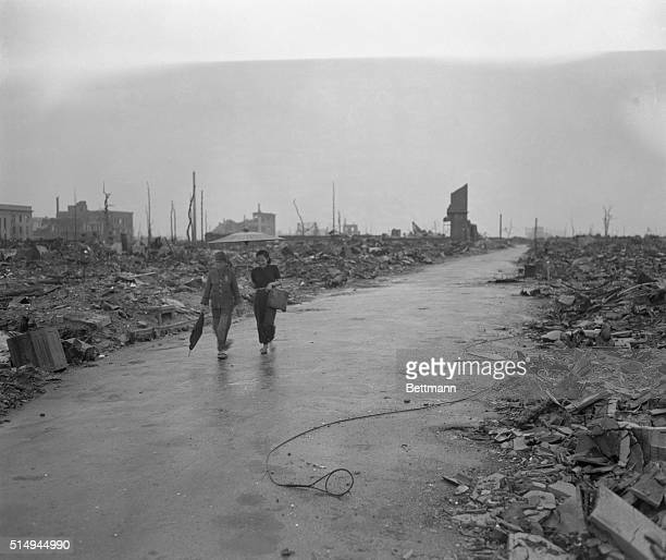 This is Hiroshima first of the world's cities to feel the brunt of the atomic bomb shortly after the attack Two stilldazed citizens walk along a...