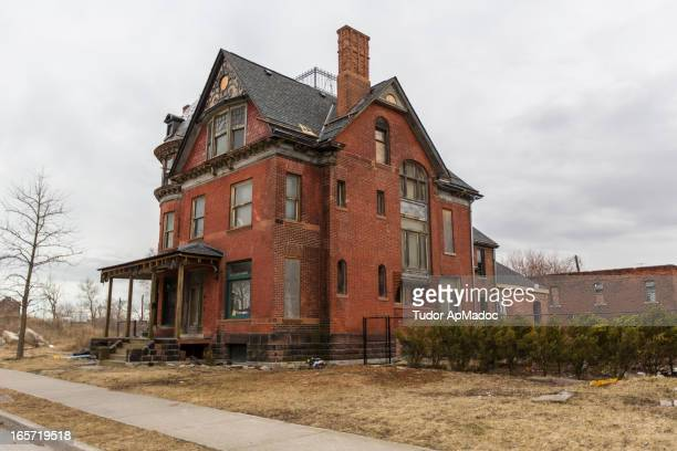 This is house had been abandoned for many years, is in the process of being renovated. It sits in an area of vacant lots just north of Comerica Park