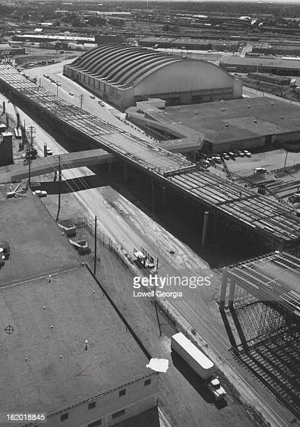 AUG 23 1962 AUG 26 1962 This is Interstate 70 looking southeast along E 46th Ave Under construction in the upper part of the photo is the threelane...