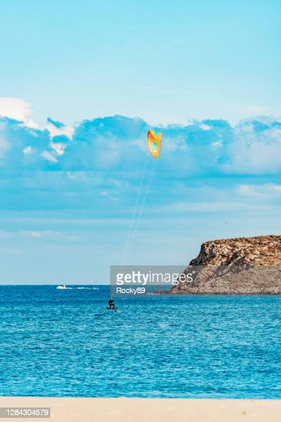 this is kite foiling  – praia do martinhal, sagres, portugal - sagres stock pictures, royalty-free photos & images