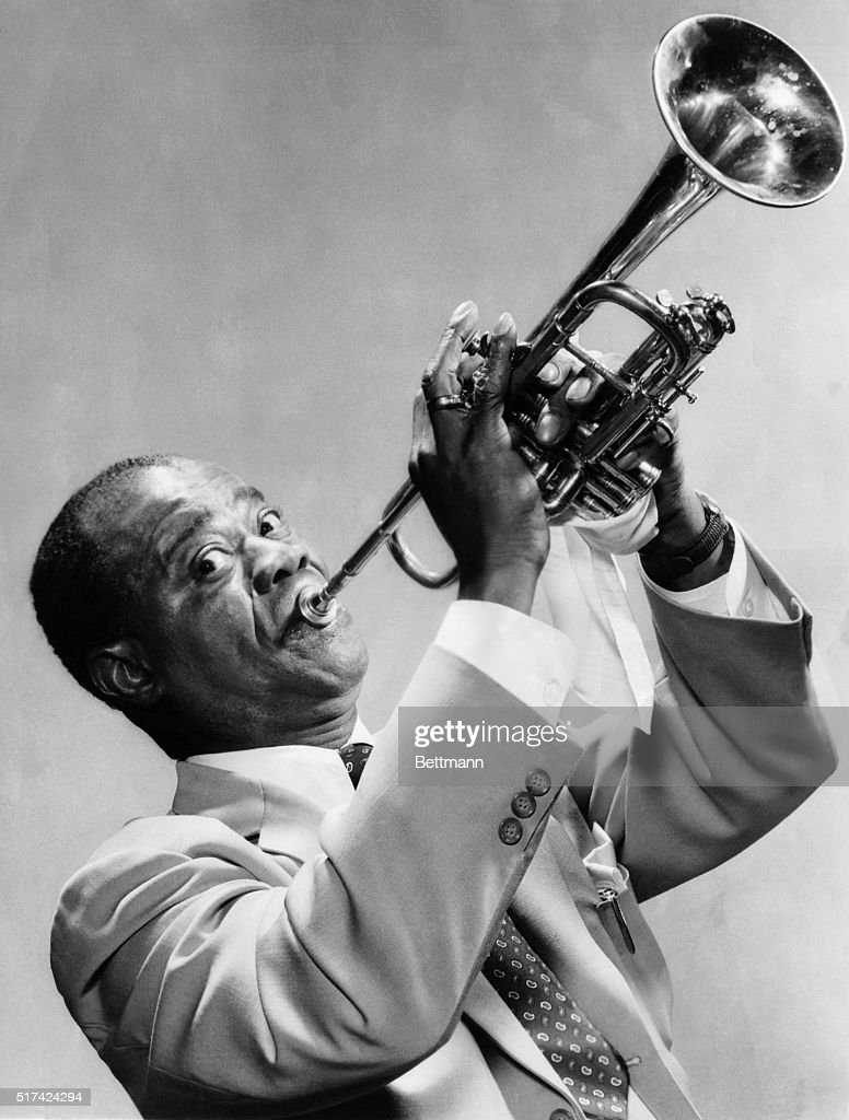 Louis Armstrong Playing the Trumpet : News Photo